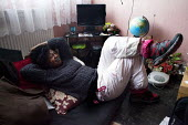 An unemployed women at home in her council flat in a tower block, Leverton, Sheffield - Connor Matheson - 04-04-2013
