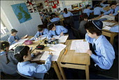 King David Jewish Junior School in Cheetham Hill, Manchester. - Christopher Thomond - ,2000s,2004,attentive,bme minority ethnic,boy,boys,bright,cap,caps,child,CHILDHOOD,children,class,classroom,classrooms,CONCENTRATE,concentrating,diligent,edu education,english,faith,Faith School,Faith