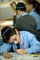 King David Jewish Junior School in Cheetham Hill, Manchester. - Christopher Thomond - ,2000s,2004,badge,badges,bme minority ethnic,boy,boys,cap,caps,child,CHILDHOOD,children,class,classroom,classrooms,CONCENTRATE,concentrating,diligent,edu education,english,faith,Faith School,Faith Sch