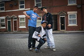 Youth on the streets of Eastwood, Rotherham. - Connor Matheson - 2010s,2014,adolescence,adolescent,adolescents,asian,asians,BAME,BAMEs,Black,BME,bmes,boy,boys,child,CHILDHOOD,children,cities,city,diversity,EQUALITY,ethnic,ethnicity,excluded,exclusion,HARDSHIP,Housi