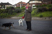 A woman with her dog, Thyberg, Rotherham. - Connor Matheson - 2010s,2014,animal,animals,canine,cities,city,dog,dogs,FEMALE,owner,owners,OWNERSHIP,people,person,persons,pet,pets,scene,scenes,street,streets,urban,walk,walking,woman,women,Yorkshire