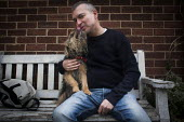 Paul kissing his dog Bella, Cudworth, Barnsley. - Connor Matheson - 2010s,2014,animal,animals,canine,cities,city,dog,dogs,KISS,kissing,male,man,men,owner,owners,OWNERSHIP,people,person,persons,pet,pets,urban,Yorkshire
