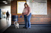 Solo and Amy in Sheffield Bus station. - Connor Matheson - 2010s,2014,animal,animals,Bus,bus service,BUSES,canine,cities,city,disabilities,disability,disable,disabled,disablement,dog,dogs,fat,FEMALE,incapacity,minorities,needs,obese,obesity,over weight,overwe