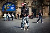 A man with his dog, Sheffield train station. - Connor Matheson - 2010s,2014,animal,animals,BAME,BAMEs,Black,BME,bmes,canine,cities,city,diversity,dog,dogs,ethnic,ethnicity,male,man,men,minorities,minority,network,owner,owners,OWNERSHIP,people,person,persons,pet,pet