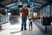 Buddy with his owner, Sheffield Bus station. A man with his dog, Upperthorpe Sheffield. - Connor Matheson - 2010s,2014,animal,animals,Bus,bus service,Bus Stop,BUSES,canine,cities,city,dog,dogs,male,man,men,owner,owners,OWNERSHIP,people,person,persons,pet,pets,public,service,services,Sheffield,transport,tran