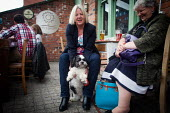 Maudy with her owner, The Riverside pub, Sheffield city centre. Paul kisses his dog Bella, Cudworth Barnsley. - Connor Matheson - 03-05-2014