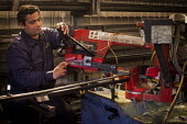 A Bulgarian steel fabricator cuts peices of metal for fabrication, Railway Arches Peckham. - Connor Matheson - 26-05-2014