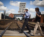 "Paul Nuttall, who is a member of B.R.A.G and a ""Freedom Rider"" that was recently arrested at Sheffield train station for fare evasion, marches around Barnsley train station to demonstrate against cuts... - Connor Matheson - 28-07-2014"