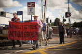 Freedom Riders march around Barnsley train station to demonstrate against cuts to free rail travel for pensioners. Barnsley, South Yorkshire. - Connor Matheson - 28-07-2014