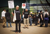 Freedom Riders rally outside Barnsley interchange to demonstrate against cuts to free rail travel for pensioners. Barnsley, South Yorkshire. - Connor Matheson - 28-07-2014
