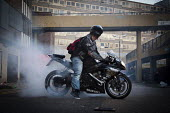 Burning rubber. Doing a wheel spin on a Suzuki GSX-R 600 motorcycle at the abandoned Heygate Estate. London - Connor Matheson - ,2010s,2012,abandoned,anti social behavior,antisocial behaviour,BAME,BAMEs,behavior,behaviour,bike,bikes,Black,blocks,BME,bmes,building,buildings,burn,burning,BURNS,CIGARETTE,cigarettes,cities,city,de