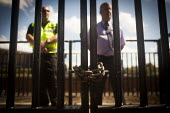 Northern rail staff stand by a chained gate to Barnsley train station in order to stop disabled freedom riders with valid train passes from gaining access to the platform. The gate is usualy open and... - Connor Matheson - 28-07-2014