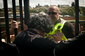 Tim Jones pushes past northern rail staff in order to let disabled freedom riders with valid train passes to gain access to the platform. Only freedom riders with valid passes attempted to gain access... - Connor Matheson - 28-07-2014