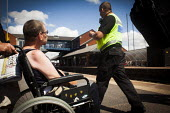 Disabled freedom riders with valid train passes gain access to Barnsley train station and wait for a train to Wakefield. Barnsley, South Yorkshire. - Connor Matheson - 28-07-2014