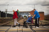 Barnsley Freedom Riders corss the level crossing. Barnsley train station, South Yorkshire. - Connor Matheson - 21-08-2014
