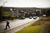 A view of typical housing. Thrybergh, Rotherham, South Yorkshire. - Connor Matheson - 2010s,2014,cityscape,cityscapes,communities,community,cross,crosses,crossing,EBF,Economic,Economy,highway,house,houses,housing,male,man,men,outdoors,outside,pedestrian,pedestrians,people,person,person