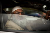 A Pakistani man in his car out side Chapel Walk Mosque. Rotherham Centre, South Yorkshire. - Connor Matheson - 29-08-2014