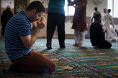 Muslim pray during Friday prayer. Rotherham Centre, South Yorkshire. - Connor Matheson - &,2010s,2014,asian,asians,BAME,BAMEs,belief,Black,BME,bmes,child sexual abuse,cities,city,conviction,diversity,ethnic,ethnicity,faith,GOD,islam,islamic,LIFE,local community,male,man,men,minorities,min