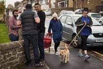 White women walk past Asian men. Rotherham Centre, South Yorkshire. - Connor Matheson - 29-08-2014