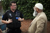 Police reassure Rotherham Muslims of their saftey during a far right protest, Rotherham, South Yorkshire. - Connor Matheson - Protest,2010s,2014,activist,activists,adult,adults,age,ageing population,asian,asians,BAME,BAMEs,Black,BME,bmes,CAMPAIGNING,CAMPAIGNS,child sexual abuse,cities,city,CLJ,communicating,communication,com