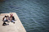 Local young people relaxing out of the way of tourists. sliema, Malta. - Connor Matheson - 2010s,2015,COAST,coastal,coasts,eu,european,europeans,eurozone,FEMALE,holiday,holiday maker,holiday makers,holidaymaker,holidaymakers,holidays,Leisure,LFL,LIFE,Local,male,Maltese,man,men,OCEAN,PEOPLE,