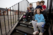 Young children sitting on the steps at the back of a local pub with boarded up houses in the background. Goldthorpe, South Yorkshire. - Connor Matheson - 17-04-2013