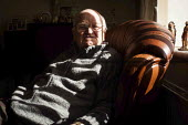 John, an ex miner in his living room. South Heindley, Barnsley, South Yorkshire. - Connor Matheson - 07-05-2014
