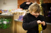 A young girl buying her favourite sweets. The Community Shop, Goldthorpe, South Yorkshire. - Connor Matheson - 16-12-2014