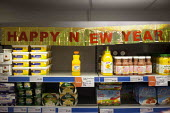 Happy New Year, Prices and festive decorations. The Community Shop, Goldthorpe, South Yorkshire. - Connor Matheson - 2010s,2014,bought,buy,buyer,buyers,buying,commodities,commodity,communities,Community,consumer,consumers,customer,customers,decorations,EBF Economy,EMOTION,EMOTIONAL,EMOTIONS,food,FOODS,Goldthorpe,goo