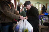 A local man is given some food by a volunteer. Gateway food bank, Barnsley Centre. - Connor Matheson - 29-01-2015