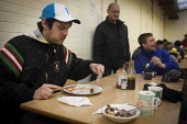 Clients eating donated breakfast. The Drop in Kitchen, Barnsley Centre. - Connor Matheson - 2010s,2015,assisting,Barnsley Churches DropIn Project,Belief,breakfast,charitable,charity,christian christianity,christian christians,church churches,eat eating,eating,EQUALITY,excluded,exclusion,food