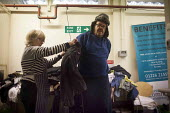 Local men trying on donated clothes, each person can take up to two items per visit. The Drop in Kitchen, Barnsley Centre. - Connor Matheson - 02-02-2015