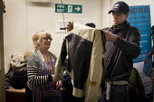 Local men trying on donated clothes, each person can take up to two items per visit. The Drop in Kitchen, Barnsley Centre. - Connor Matheson - ,2010s,2015,assisting,Barnsley Churches DropIn Project,Belief,charitable,charity,christian christianity,christian christians,church churches,clothes,clothes clothing,donated donations,EQUALITY,exclude