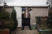 An ex miner lifting weights in his back garden. Ryhill, Wakefield, South Yorkshire. - Connor Matheson - 28-02-2015