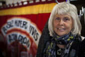 Anne Scargil posing for a portrait during Banners Held High, an event that marks the end of the 1984-1985 miners strike. Unity Centre, Wakefield, South Yorkshire. - Connor Matheson - 2010s,2015,age,ageing population,BANNER,banner banners,Banners,disputes,elderly old,INDUSTRIAL DISPUTE,member,member members,members,MINER,miners,MINER'S,miners strike miner's strike NUM,num,old,peopl