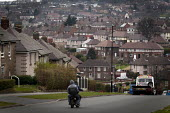 Youth riding a small motorbike without helmets. Shirecliffe, Sheffield, South Yorkshire. - Connor Matheson - , CLJ,2010s,2015,anti social behavior,antisocial behaviour,behavior,behaviour,bike,bikes,building,buildings,cities,city,CLJ,enjoying,enjoyment,fun,having fun,hazard,hazardous,HAZARDS,helmet,helmets,hi