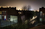 A view of housing by the canal. Highfield, Sheffield, South Yorkshire.. - Connor Matheson - 2010s,2015,at,building,buildings,cities,city,City centre,cityscape,cityscapes,footpath,footpaths,house,houses,housing,light,lighting on,lights,night,night time,outdoors,outside,path,paths,safety,scene