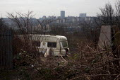 A caravan part of a alternative living community surrounded by Knotweed. Sheffield Ski Village, South Yorkshire. - Connor Matheson - 2010s,2015,Artificial Ski Slope,Burnt Out,caravan,caravans,cities,city,closed,closing,closure,closures,communities,community,degradation,derelict,DERELICTION,disused,Dry Ski Slope,EBF,Economic,Economy