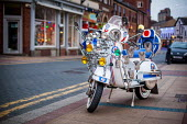 A vintage scooter decorated in Mod Fashion, Sheffield Aces Scooter Club. Sheffield Centre, South Yorkshire. - Connor Matheson - 2010s,2015,ACE,chrome,club,clubs,collector,collectors,culture,decorated,Fashion,flag,flags,hobbies,hobby,hobbyist,Lambretta,Leisure,LFL,LIFE,light,lighting on,lights,mirror,mirrors,mod,mods,PEOPLE,REC