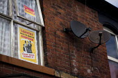 NHS Health Service Covers Everyone, Tories voted against it Historic Labour Party Poster from 1948 and Vote Labour Party poster in a window of a house. Satellite dishes, Nether Edge, Sheffield, South... - Connor Matheson - 16-04-2015