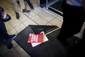 A placard on the floor of McDonalds during the Global day of action, a protest for fast food workers rights and fair pay staged by the Youth Fight for Jobs campaign and BAFWU. Sheffield Centre, South... - Connor Matheson - 2010s,2015,activist,activists,BFAWU,CAMPAIGN,campaigner,campaigners,CAMPAIGNING,CAMPAIGNS,catering,cities,city,contract,contracts,DEMONSTRATING,demonstration,DEMONSTRATIONS,EARNINGS,EQUALITY,fast food