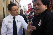 A heated argument between protesters and McDonald's manager during the Global day of action, a protest for fast food workers rights and fair pay staged by the Youth Fight for Jobs campaign and BAFWU.... - Connor Matheson - 2010s,2015,activist,activists,argue,arguing,argument,BFAWU,boss,bosses,CAMPAIGN,campaigner,campaigners,CAMPAIGNING,CAMPAIGNS,catering,cities,city,communicating,communication,communities,community,cont