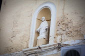 A statue of Jesus on display on the wall of a local pub. Malta is a predominantly catholic country. Saint Julians, Malta. - Connor Matheson - 21-04-2015