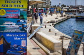 Tickets sold here. Adverts for boat cruses marketed to tourists, marina, Selima. Tourism is a vital industry for the maltese economy, contributing 15 to its GDP. Since 2009 Malta has experienced a 10... - Connor Matheson - 2010s,2015,advertisement,advertisements,advertising,boat,boats,capitalism,capitalist,coast,coastal,coasts,Cruise Ship,day out,Day Trip,EBF,Economic,Economy,eu,european,europeans,eurozone,holiday,holid