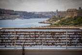 Love locks locked onto a railing at The Point, overlooking the sea and Valletta. Love locking is a trend of locking padlocks to a bridge or railing in order to symboloise love. The trend has been cotr... - Connor Matheson - 23-04-2015