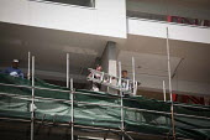 Construction workers without helmets and saftey gear, building a hotel. Sliema, Malta. - Connor Matheson - 2010s,2015,builder,builders,building,building site,Building Worker,BUILDINGS,Construction Industry,crane,cranes,EBF,Economic,Economy,employee,employees,Employment,eu,european,europeans,eurozone,hazard
