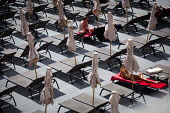 Tourists relaxing on sun loungers by the sea. Tourism is a vital industry for the maltese economy, contributing 15 to its GDP. Since 2009 Malta has experienced a 10 drop in tourism. sliema, Malta. - Connor Matheson - 23-04-2015