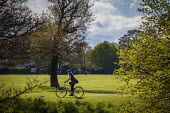 A lone cyclist in Roundhay Park, Leeds, West Yorkshire - Connor Matheson - 03-05-2015