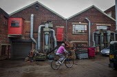 A worker riding his bike during his tea break. J Adams and Sons manufacture a range of military and cooking knives out of steel using traditional hand based production methods. The family business emp... - Connor Matheson - 18-05-2015