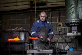The foreman handling hot steel. J Adams and Sons manufacture a range of military and cooking knives out of steel using traditional hand based production methods. The family business employs around 16... - Connor Matheson - 18-05-2015